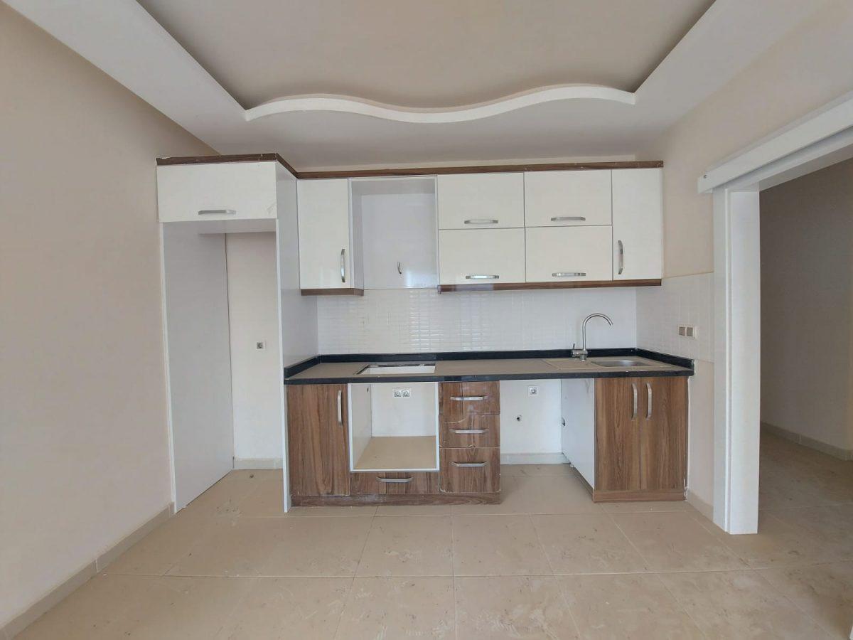Новые апартаменты 1+1 в спокойной части Махмутлара - Фото 6