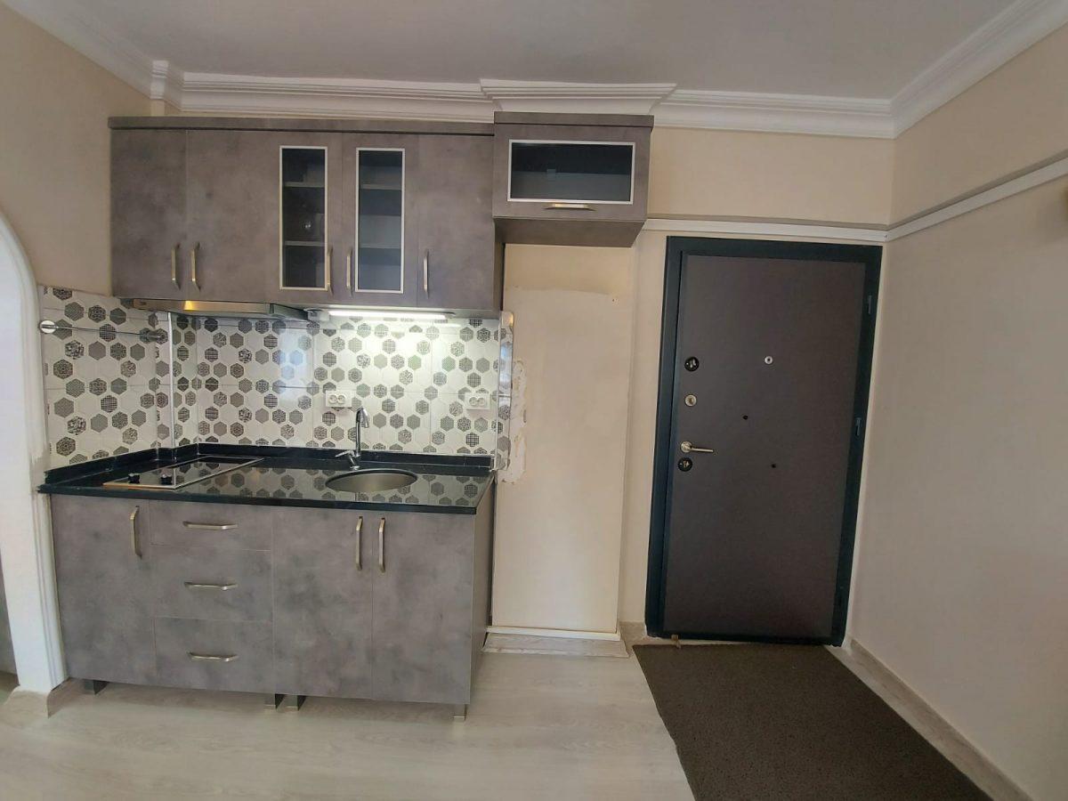 Компактные апартаменты 1+1 в спокойной части Махмутлара - Фото 3