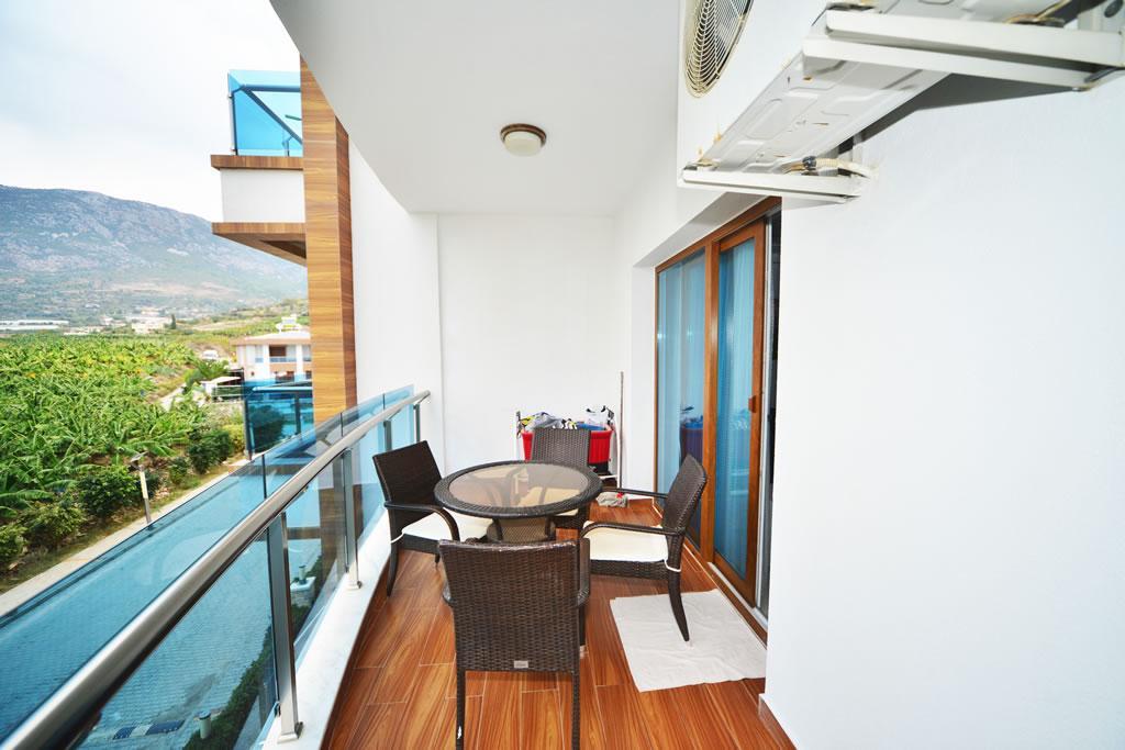 Современные апартаменты  1+1 в Махмутларе  - Фото 11