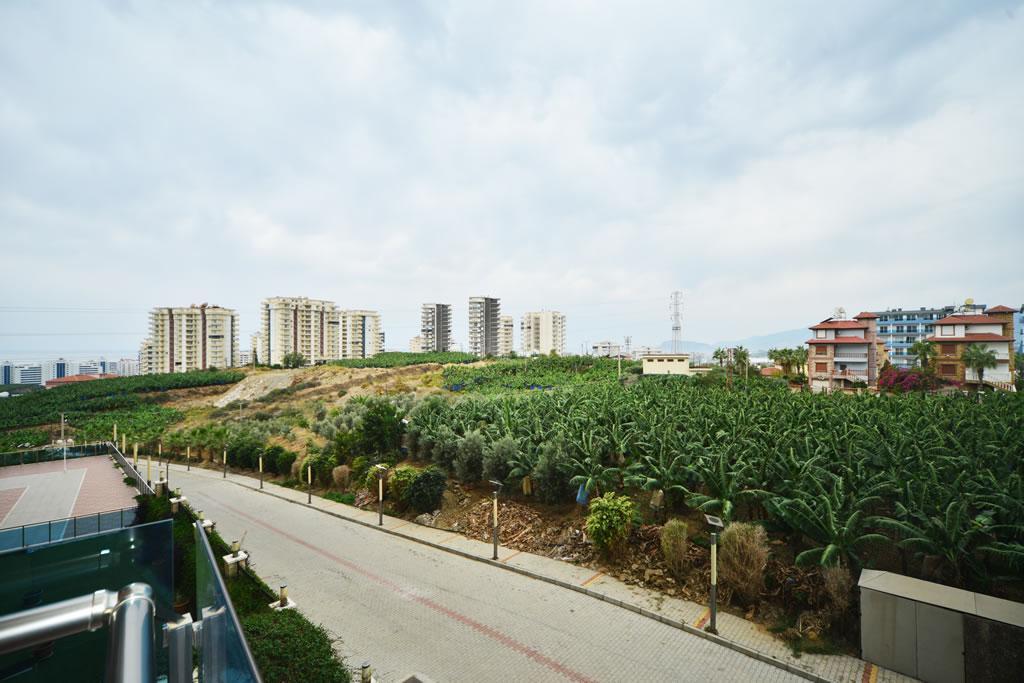 Современные апартаменты  1+1 в Махмутларе  - Фото 12