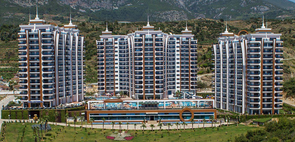 Люксовые апартаменты 3+1 в зелёном и тихом районе Махмутлара - Фото 1
