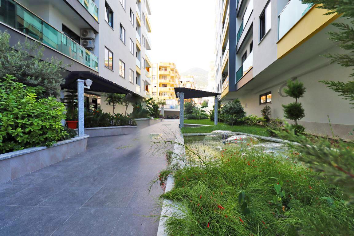 Удобные апартаменты 1+1 в центре Алании - Фото 19