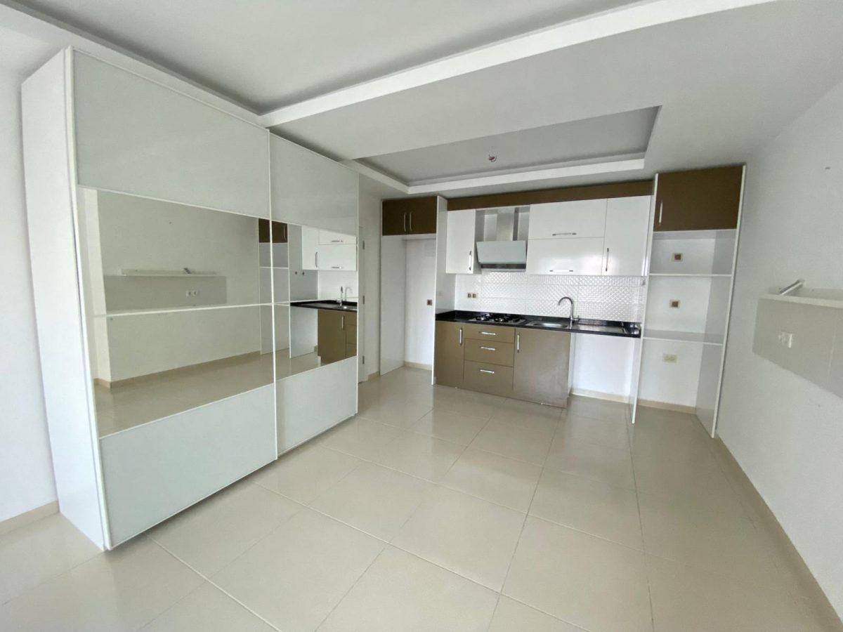 Просторная квартира 1+1 в хорошем комплексе в Махмутларе - Фото 19