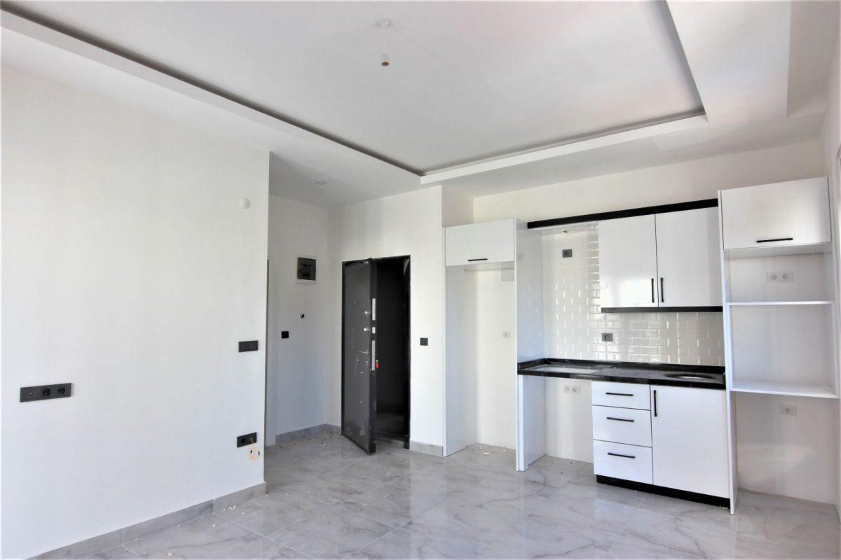 Новые светлые апартаменты 1+1 в Махмутлар - Фото 6