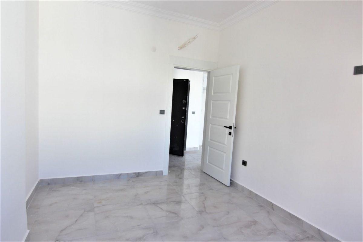 Новые светлые апартаменты 1+1 в Махмутлар - Фото 5