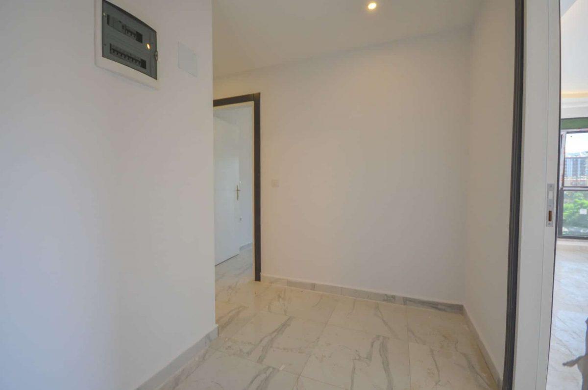 Чудесные новые апартаменты 2+1 в спокойной части Махмутлара - Фото 3