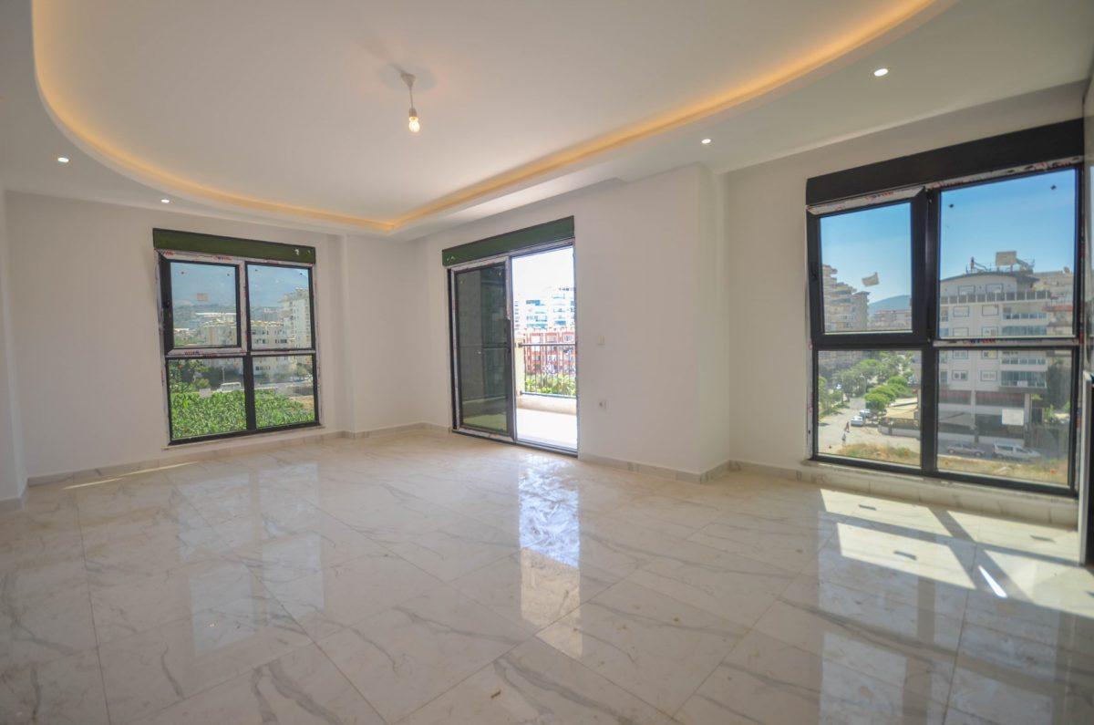 Чудесные новые апартаменты 2+1 в спокойной части Махмутлара - Фото 4