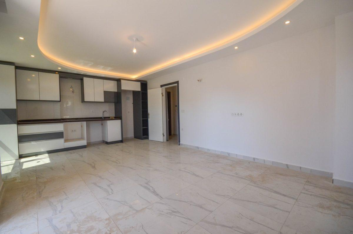 Чудесные новые апартаменты 2+1 в спокойной части Махмутлара - Фото 5