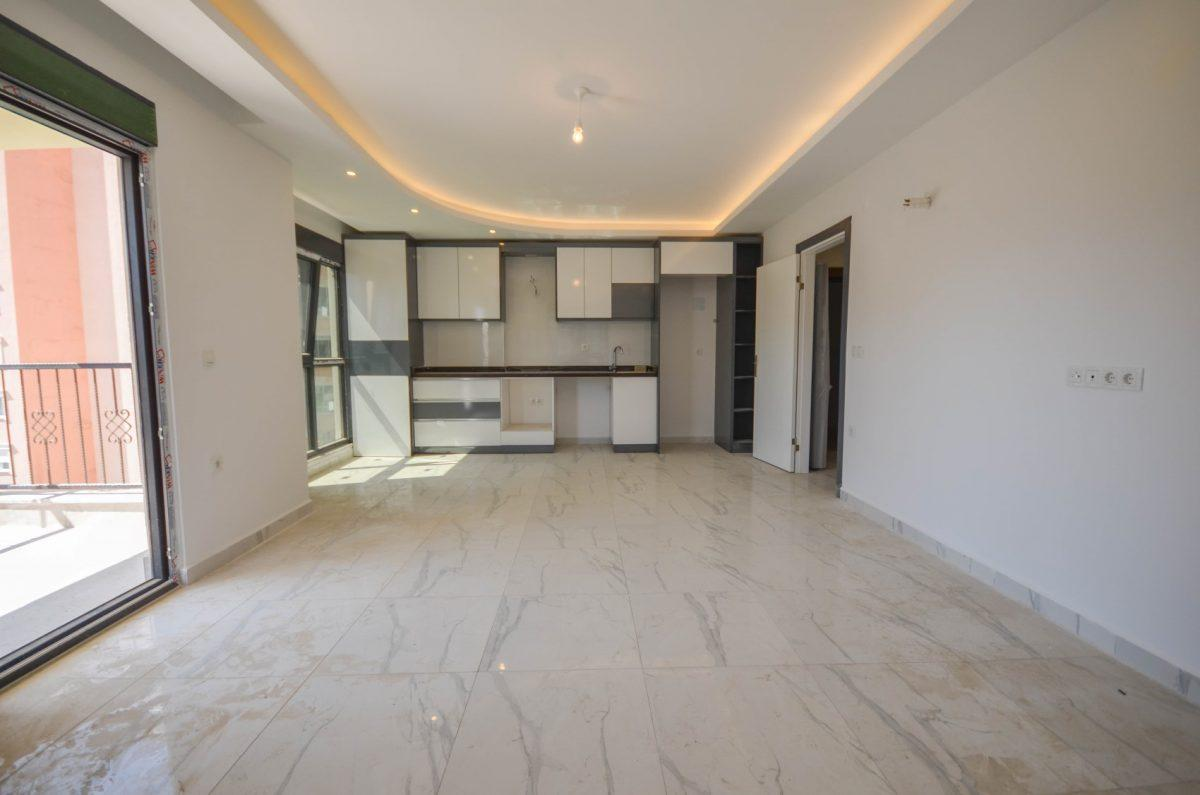 Чудесные новые апартаменты 2+1 в спокойной части Махмутлара - Фото 6