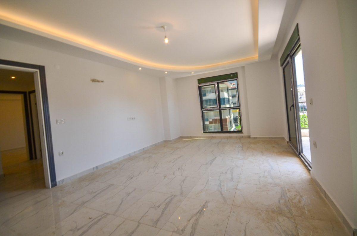 Чудесные новые апартаменты 2+1 в спокойной части Махмутлара - Фото 7