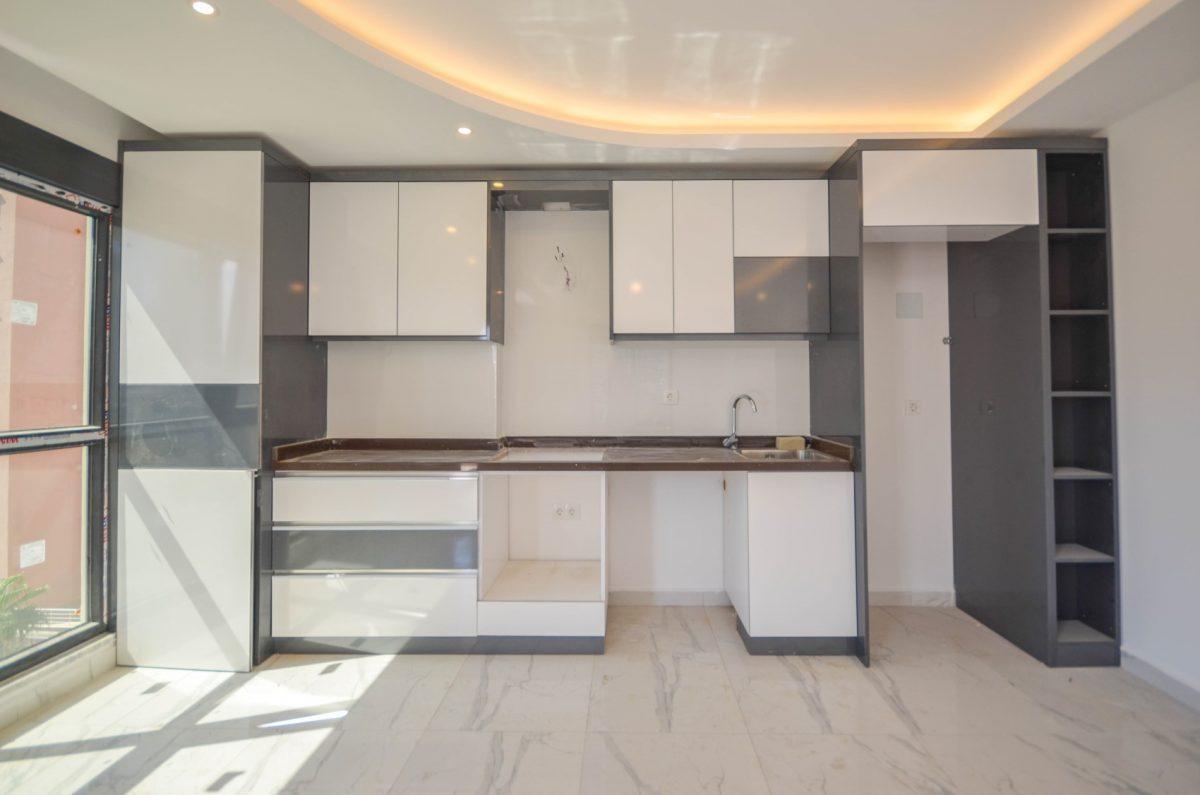 Чудесные новые апартаменты 2+1 в спокойной части Махмутлара - Фото 8