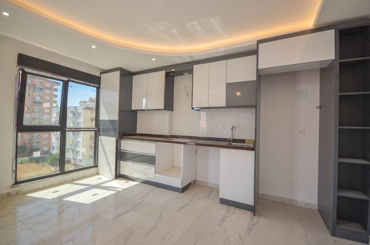 Чудесные новые апартаменты 2+1 в спокойной части Махмутлара - Фото 9