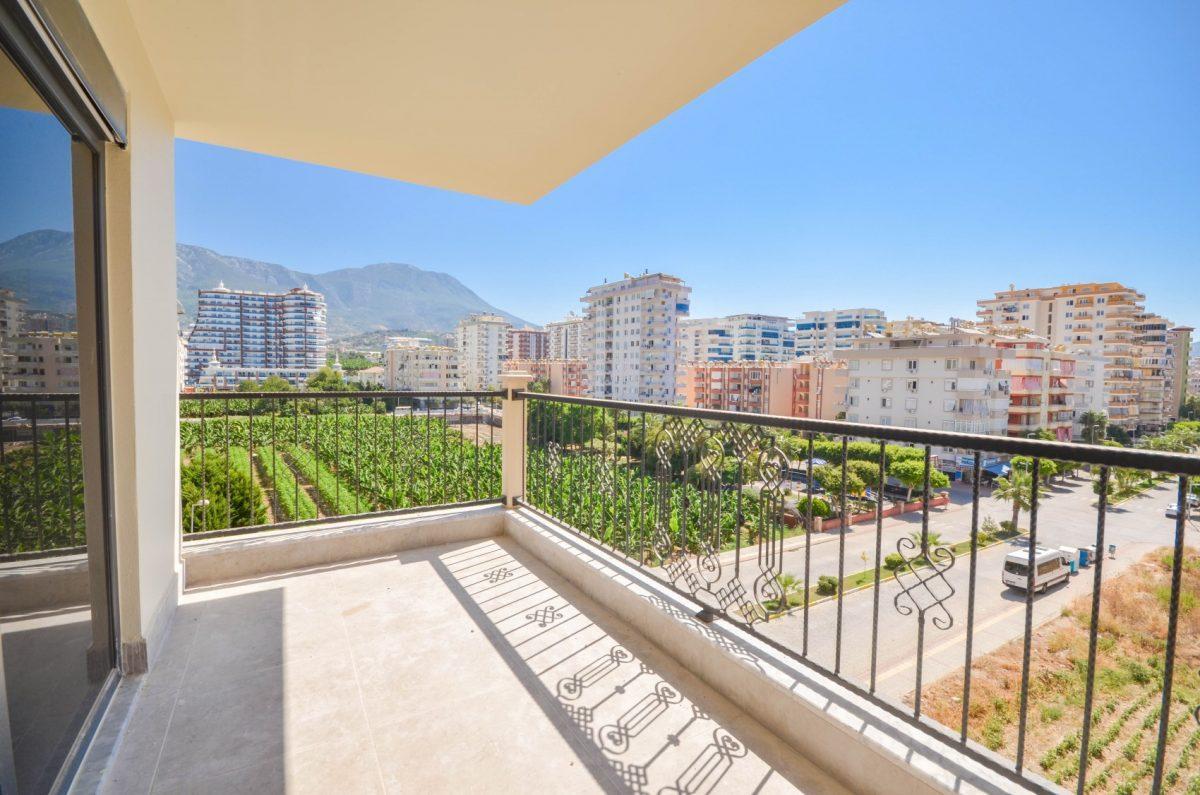 Чудесные новые апартаменты 2+1 в спокойной части Махмутлара - Фото 10