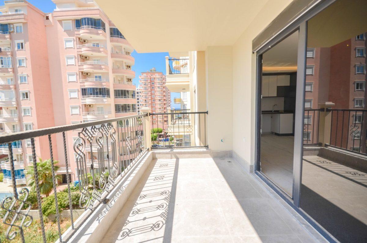 Чудесные новые апартаменты 2+1 в спокойной части Махмутлара - Фото 11
