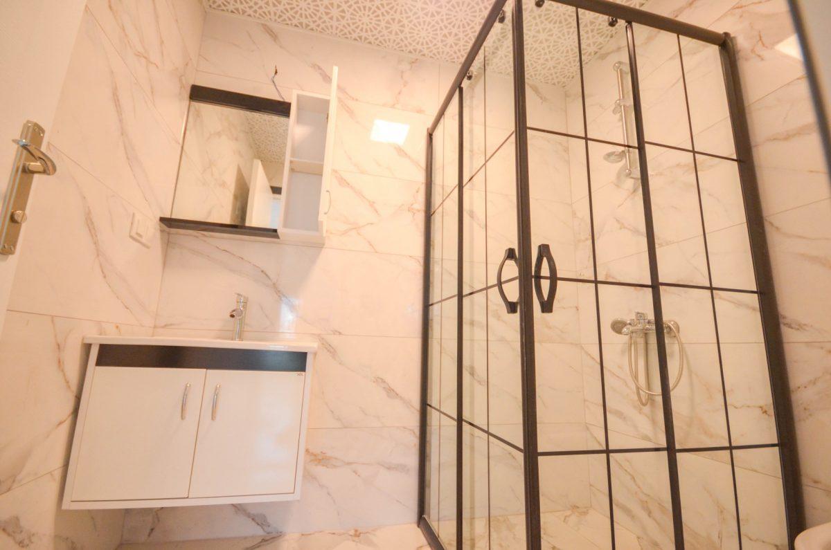 Чудесные новые апартаменты 2+1 в спокойной части Махмутлара - Фото 14