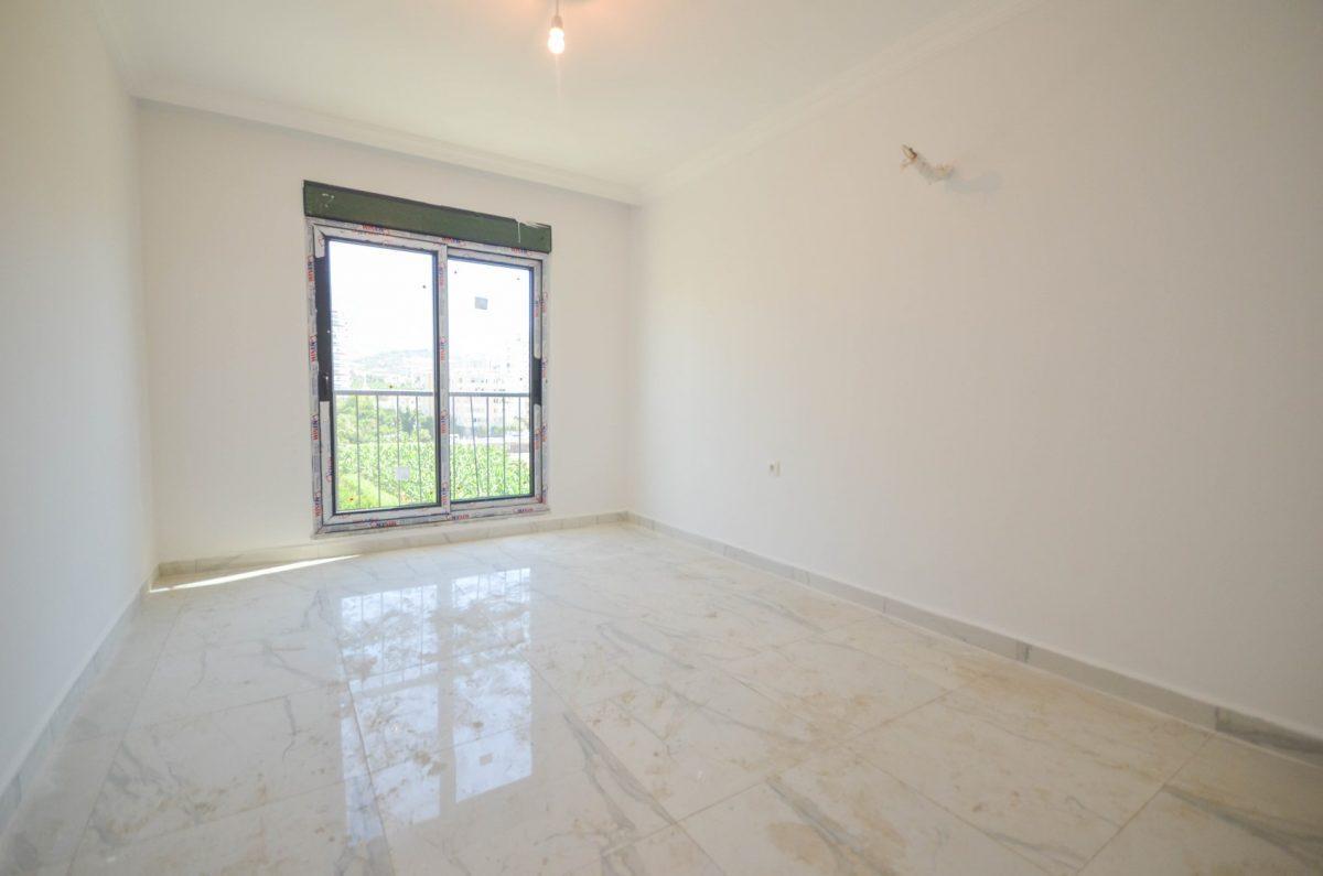 Чудесные новые апартаменты 2+1 в спокойной части Махмутлара - Фото 15
