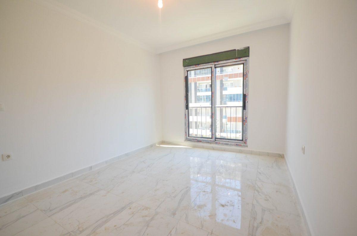 Чудесные новые апартаменты 2+1 в спокойной части Махмутлара - Фото 16