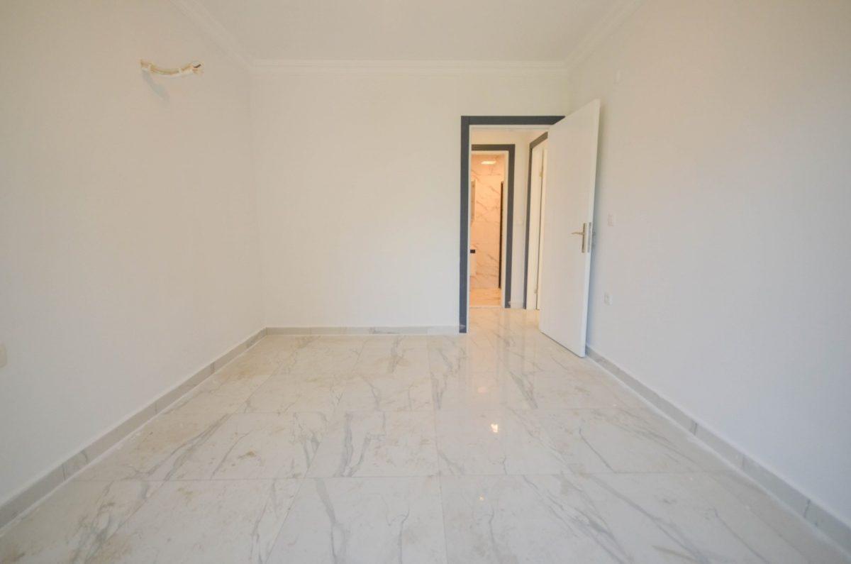Чудесные новые апартаменты 2+1 в спокойной части Махмутлара - Фото 17