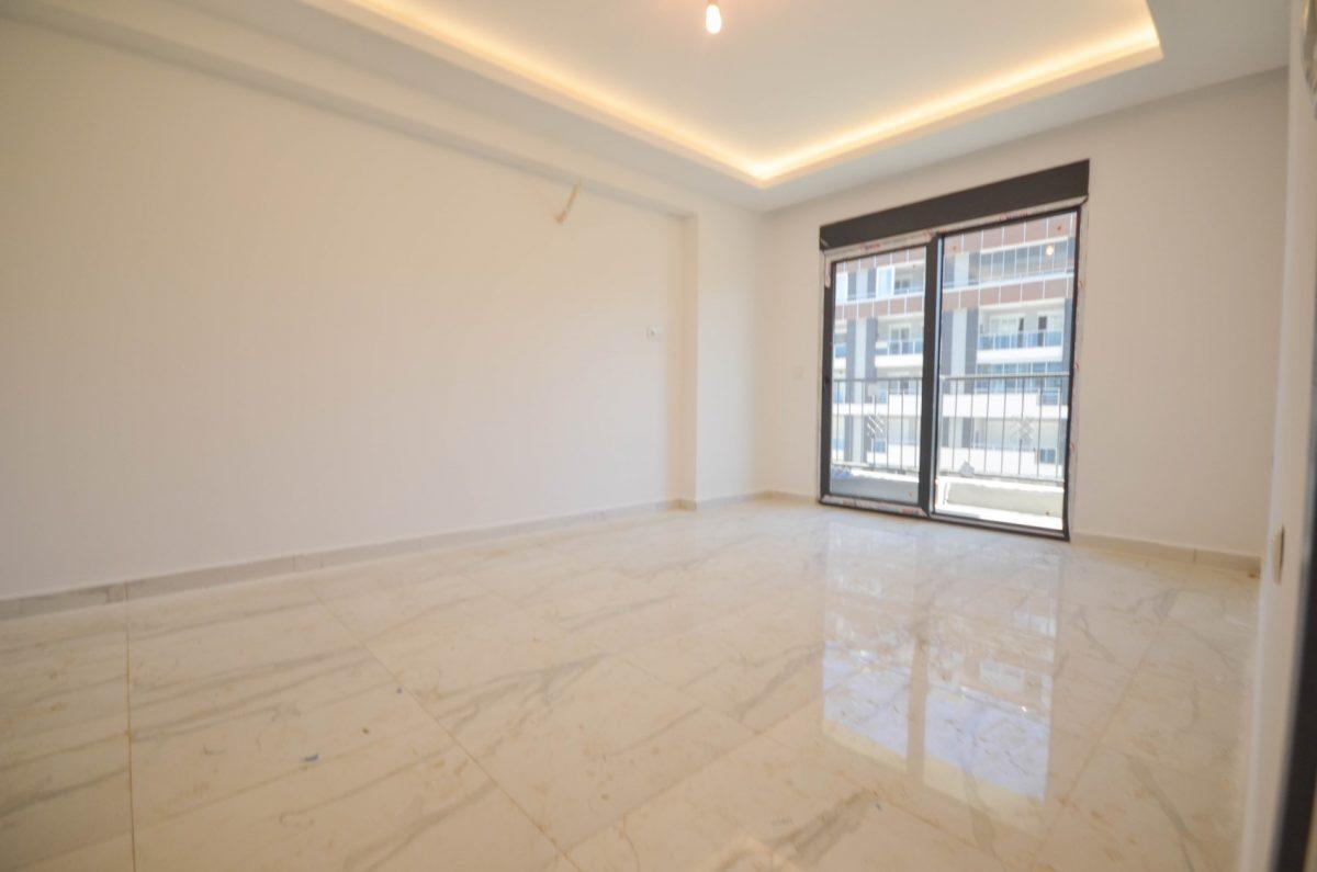 Чудесные новые апартаменты 2+1 в спокойной части Махмутлара - Фото 18