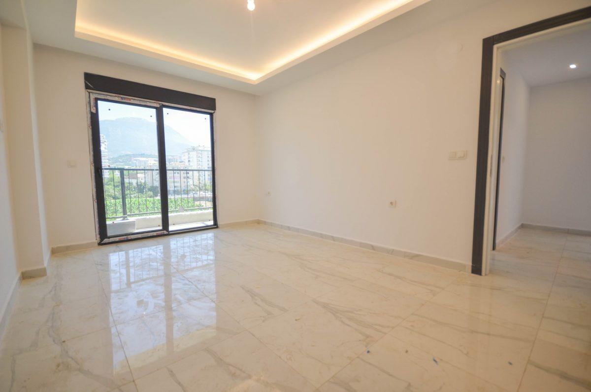 Чудесные новые апартаменты 2+1 в спокойной части Махмутлара - Фото 19