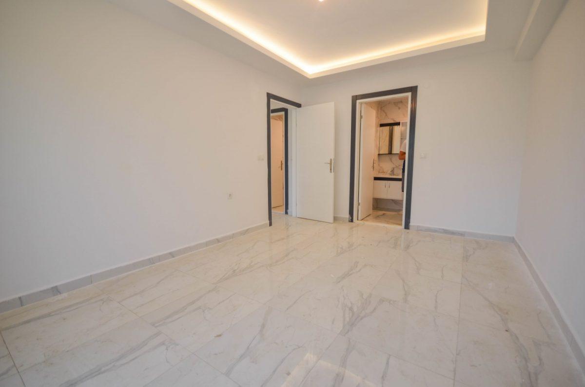 Чудесные новые апартаменты 2+1 в спокойной части Махмутлара - Фото 20