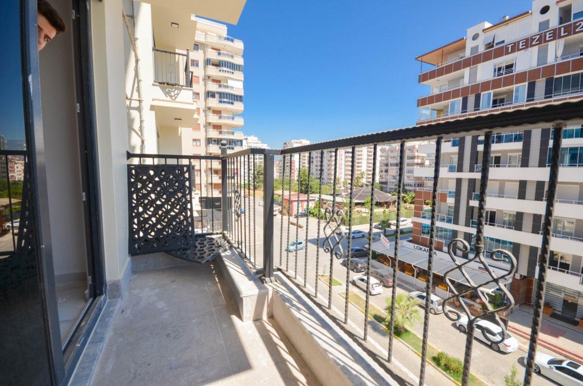 Чудесные новые апартаменты 2+1 в спокойной части Махмутлара - Фото 21