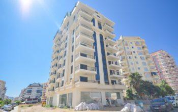 Чудесные новые апартаменты 2+1 в спокойной части Махмутлара