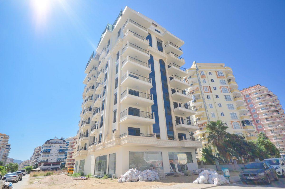 Чудесные новые апартаменты 2+1 в спокойной части Махмутлара - Фото 1