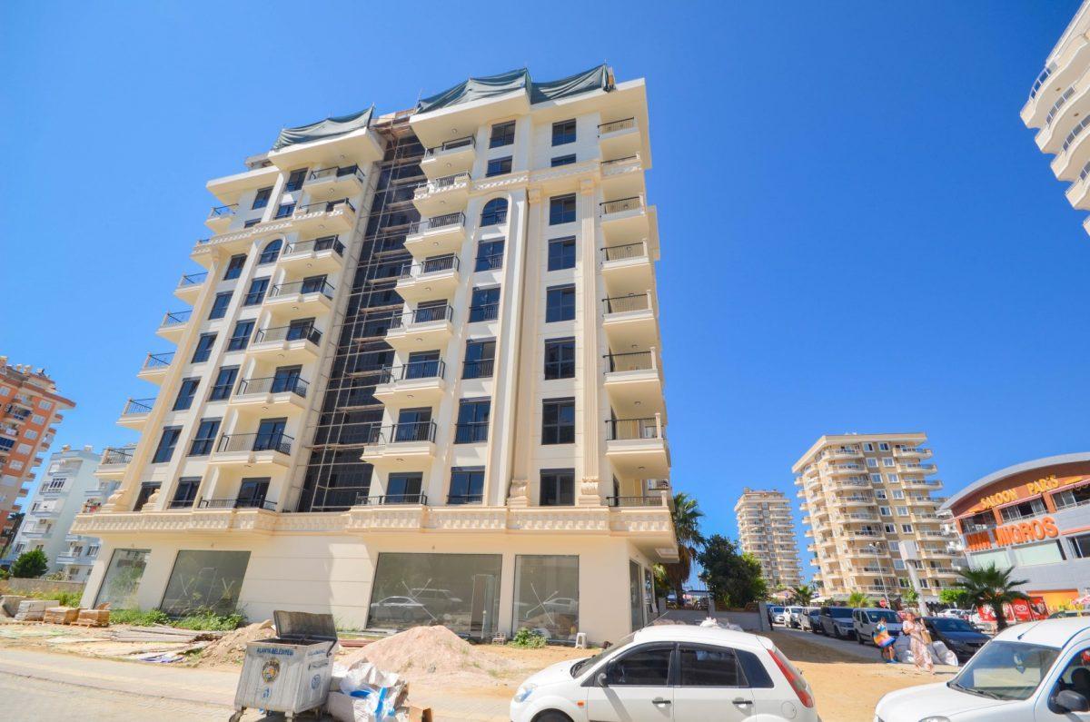 Чудесные новые апартаменты 2+1 в спокойной части Махмутлара - Фото 2