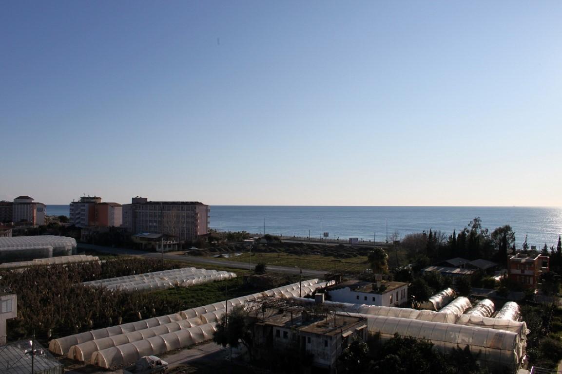 Меблированный пентхаус с видом на море в Махмутларе - Фото 18