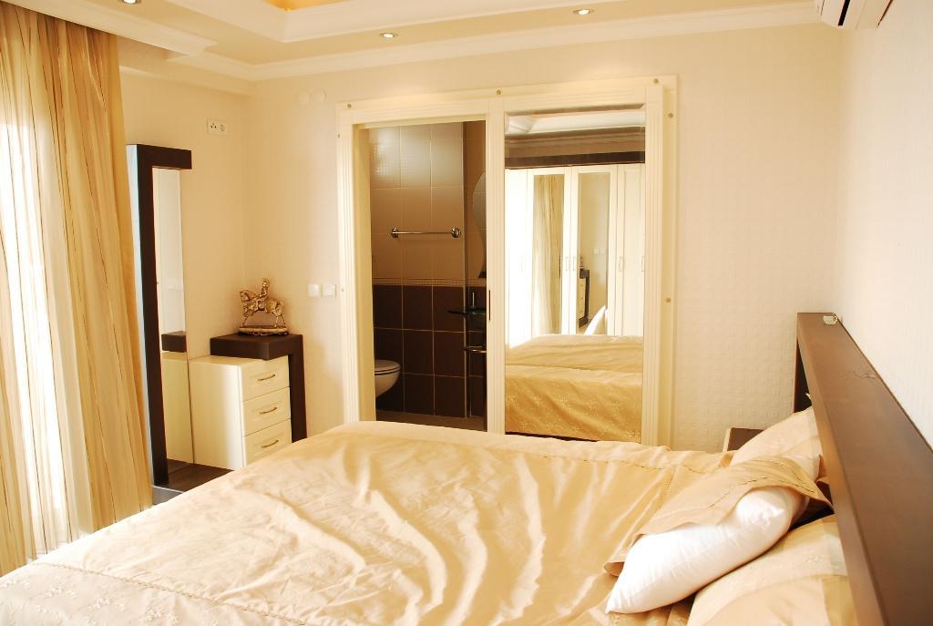 Двухуровневая квартира с тремя спальнями с панорамным видом на море в Махмутларе - Фото 16