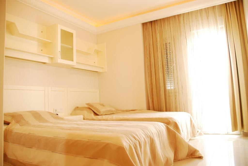 Двухуровневая квартира с тремя спальнями с панорамным видом на море в Махмутларе - Фото 19