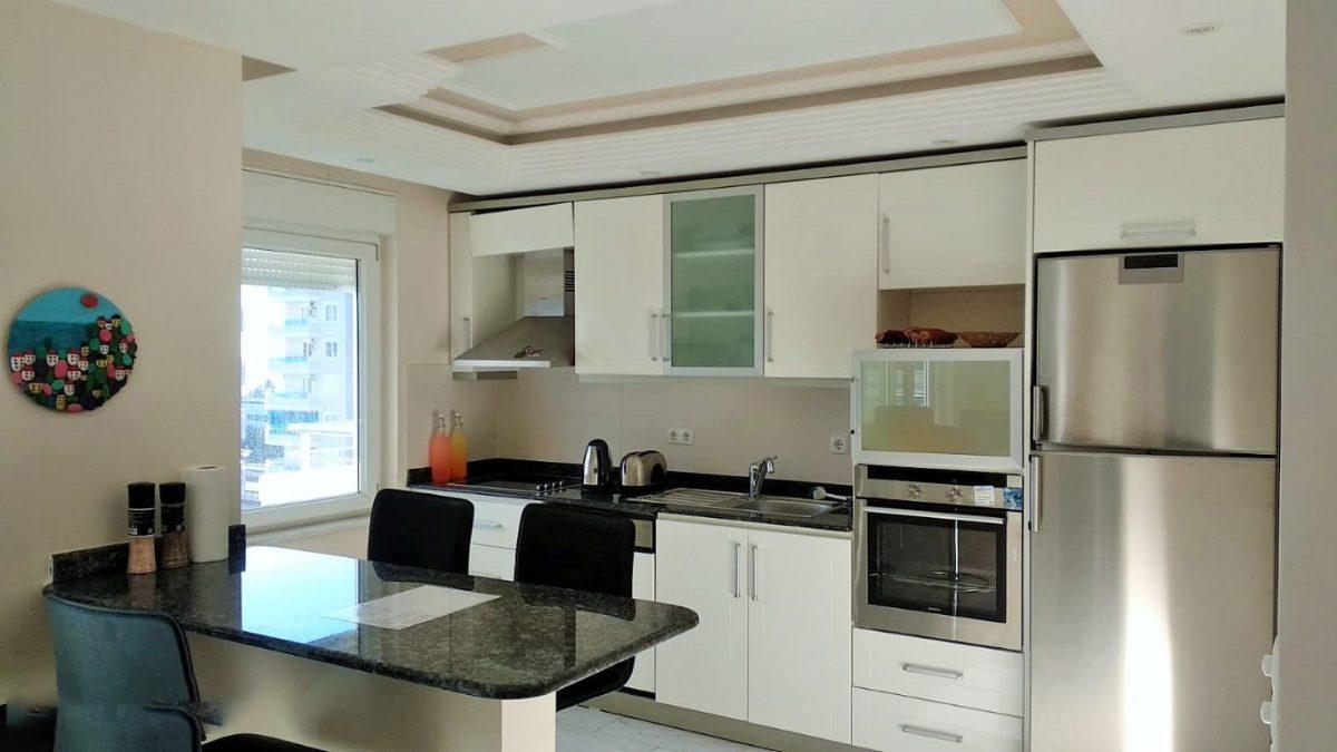 Меблированная квартира 2+1 в комплексе на первой береговой линии в Тосмуре - Фото 17