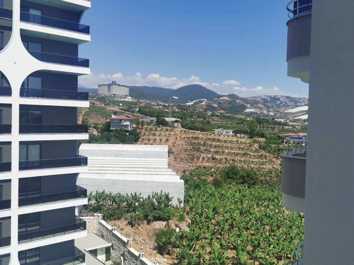 Меблированная квартира у подножия гор в Махмутларе - Фото 30