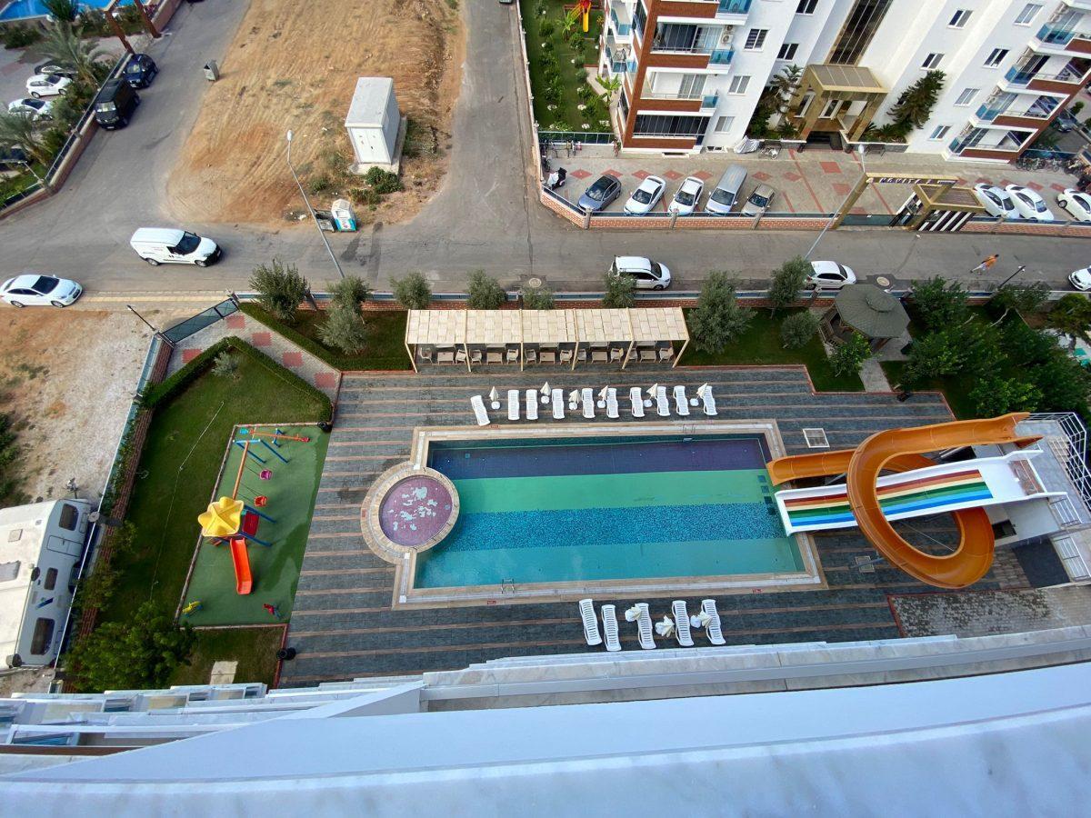 Просторная квартира 1+1 в хорошем комплексе в Махмутларе - Фото 11