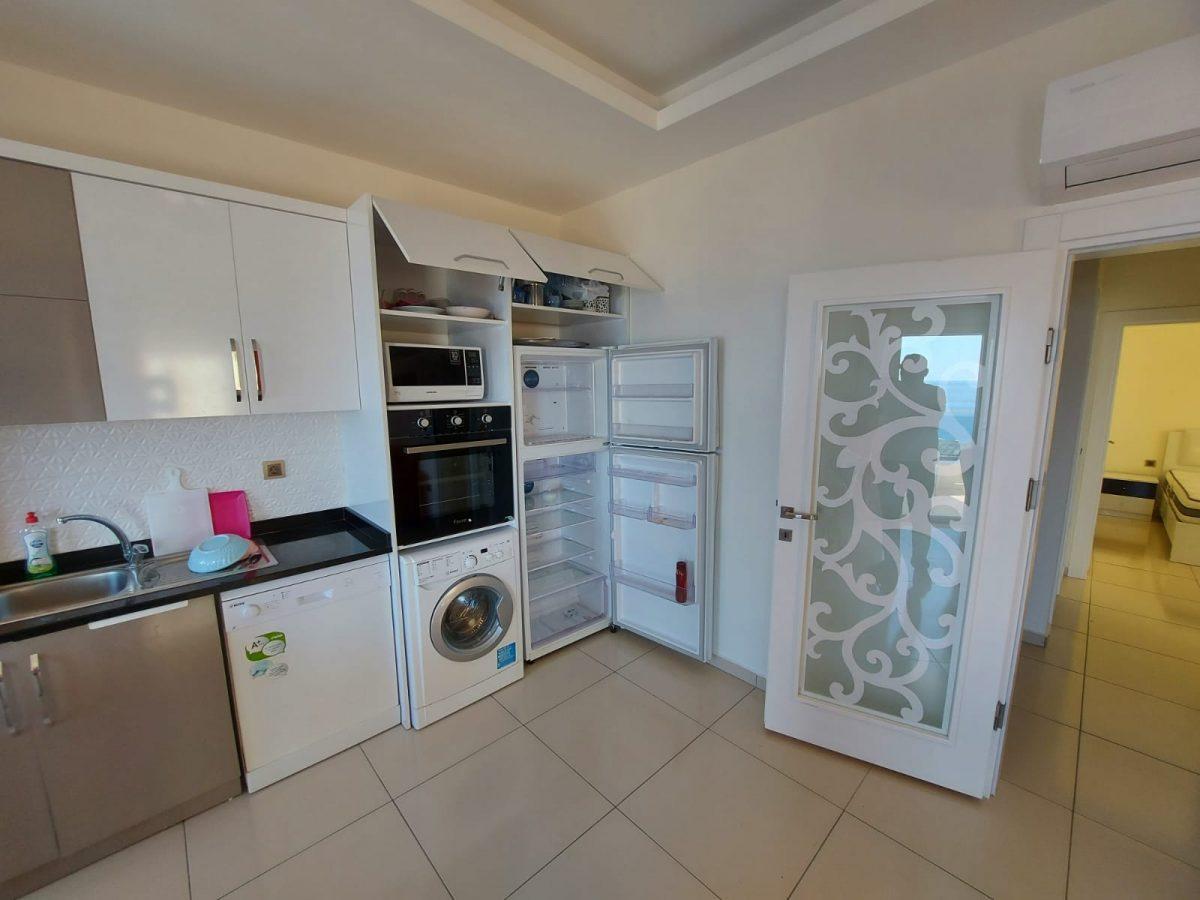 Меблированная квартира 2+1 на центральной улице в Махмутларе - Фото 15
