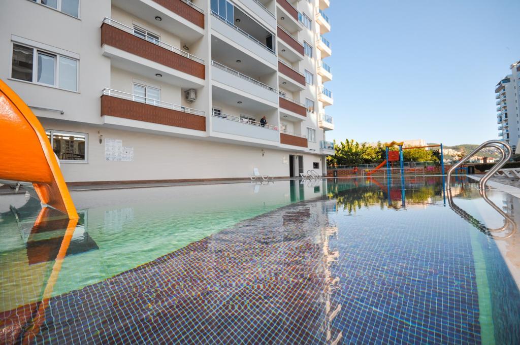 Просторная квартира 1+1 в хорошем комплексе в Махмутларе - Фото 7