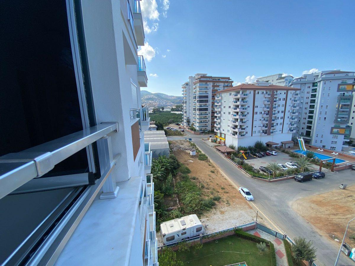 Просторная квартира 1+1 в хорошем комплексе в Махмутларе - Фото 28
