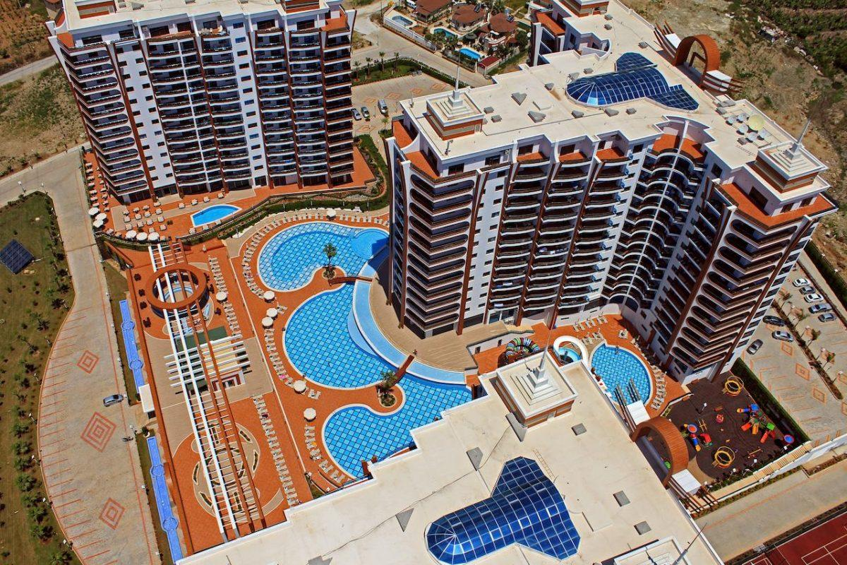 Современные апартаменты  1+1 в Махмутларе  - Фото 1