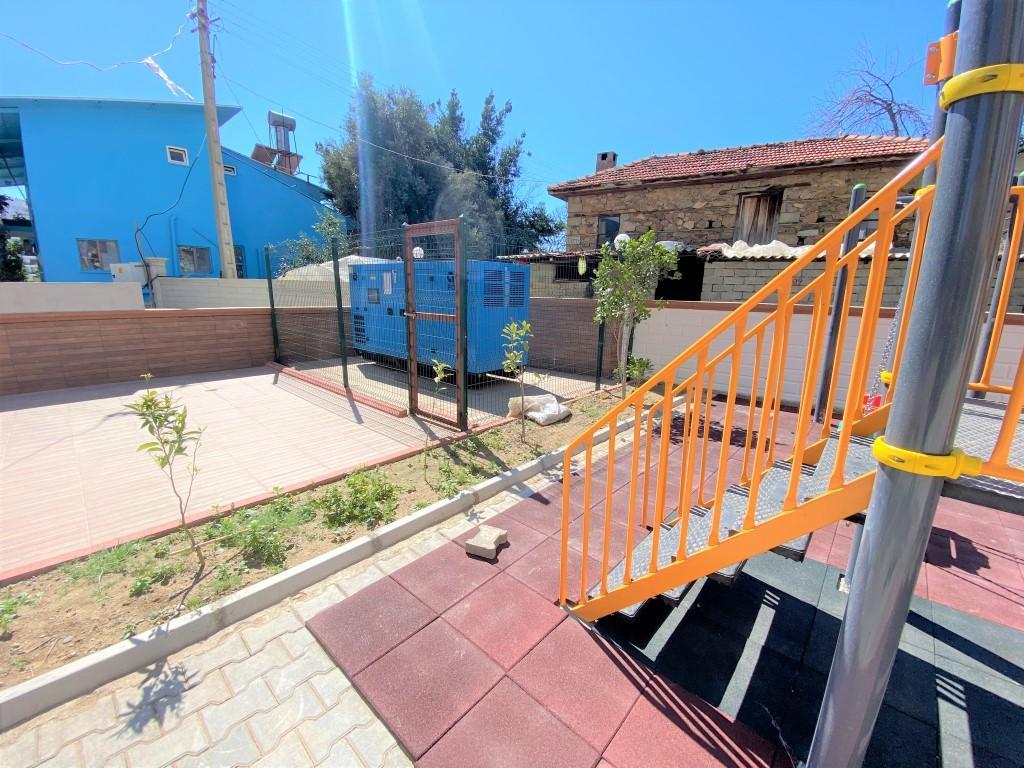 Квартира 2+1 с отдельной кухней в спокойной части Махмутлара - Фото 9