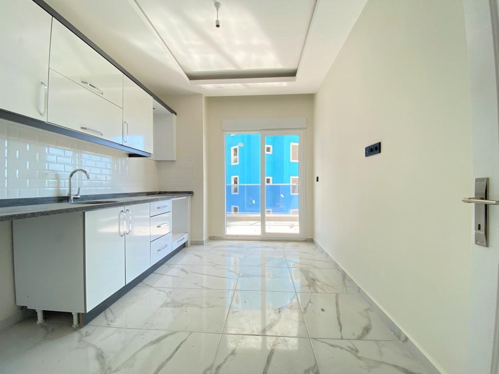 Квартира 2+1 с отдельной кухней в спокойной части Махмутлара - Фото 11