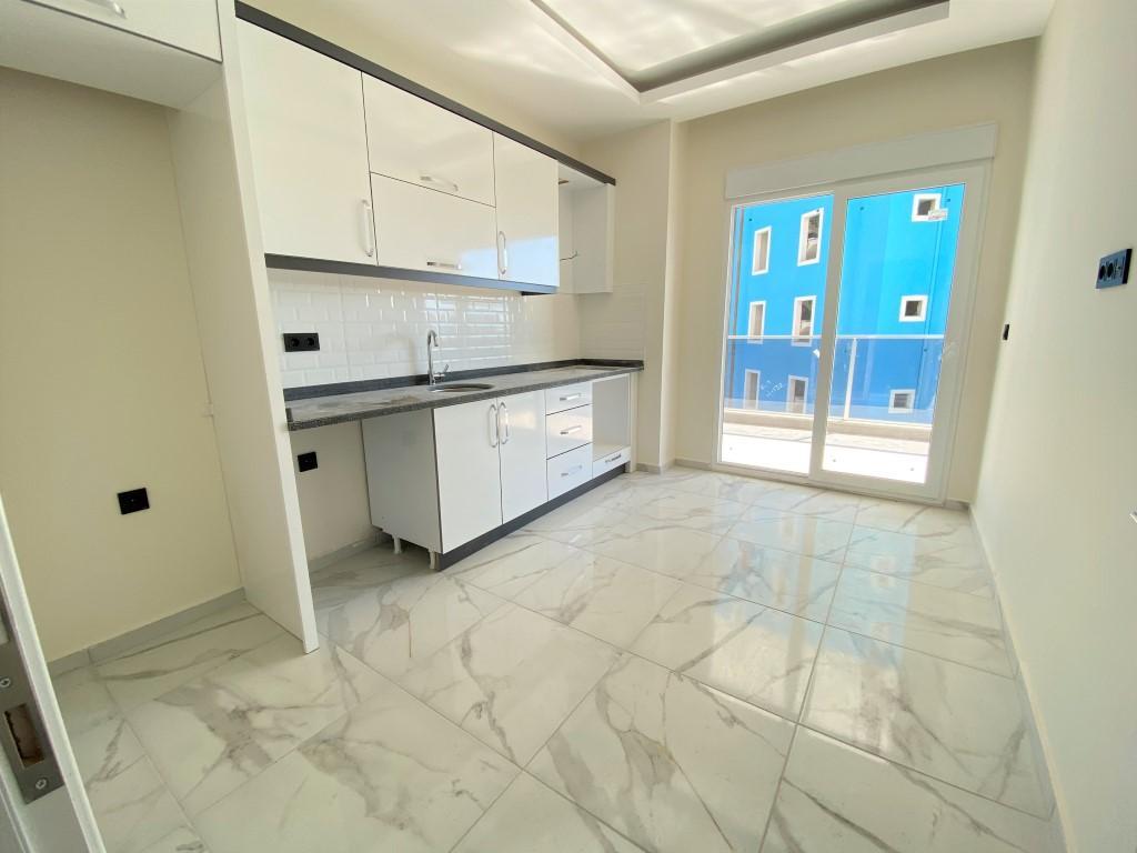 Трехкомнатная квартира с отдельной кухней в спокойной части Махмутлара - Фото 12