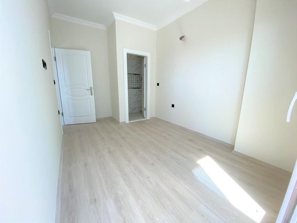 Трехкомнатная квартира с отдельной кухней в спокойной части Махмутлара - Фото 14
