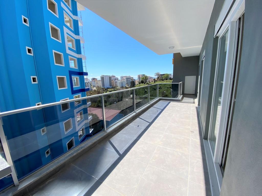 Трехкомнатная квартира с отдельной кухней в спокойной части Махмутлара - Фото 17