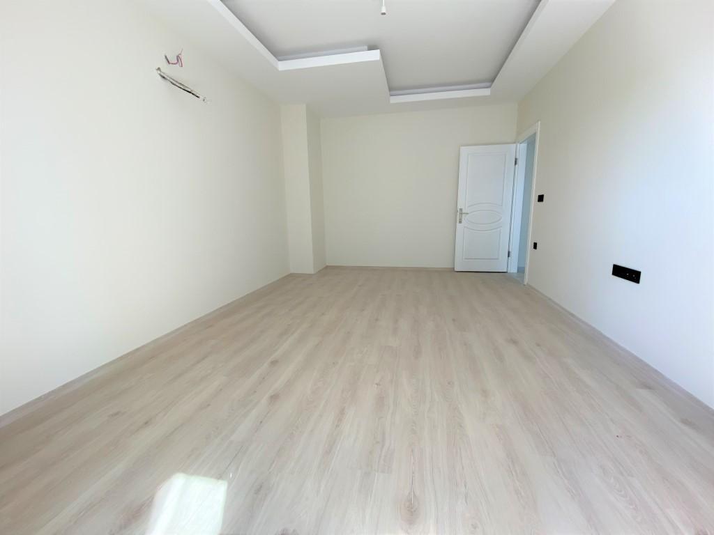 Трехкомнатная квартира с отдельной кухней в спокойной части Махмутлара - Фото 16