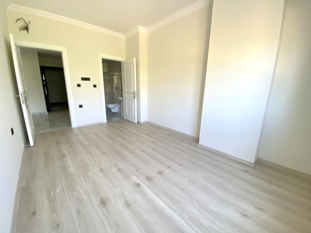 Новые просторные апартаменты 3+1 с панорамным видом в Махмутлар - Фото 14