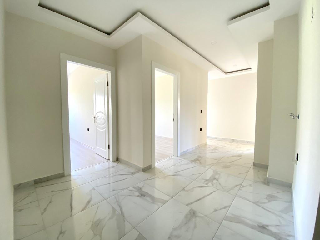 Новые просторные апартаменты 3+1 с панорамным видом в Махмутлар - Фото 15