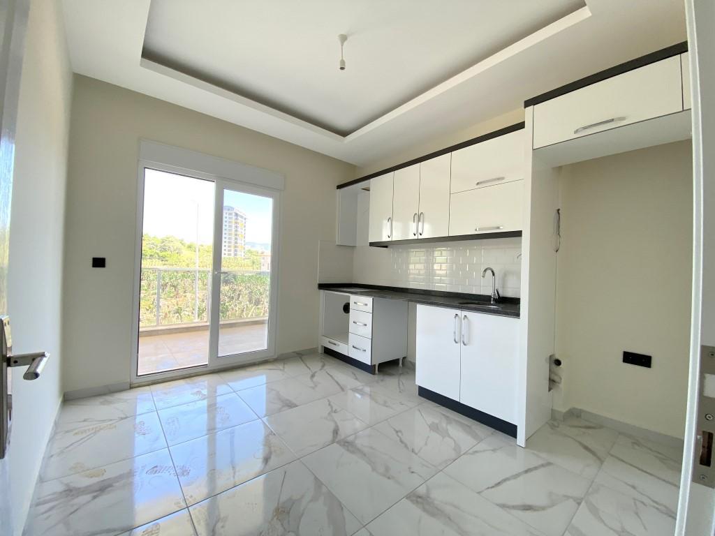 Новые светлые апартаменты 3+1 с панорамным видом в Махмутлар - Фото 13