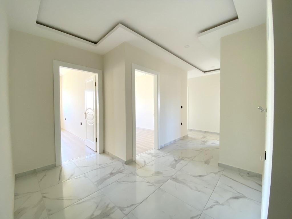 Новые светлые апартаменты 3+1 с панорамным видом в Махмутлар - Фото 14