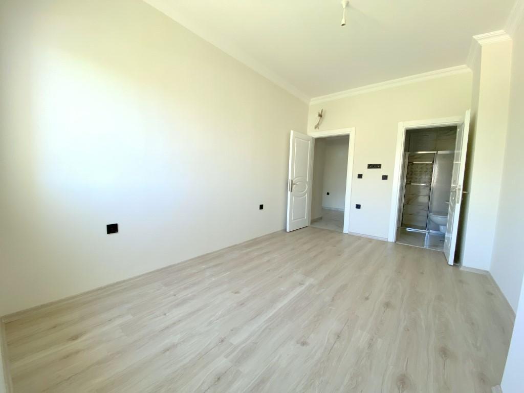 Новые светлые апартаменты 3+1 с панорамным видом в Махмутлар - Фото 15